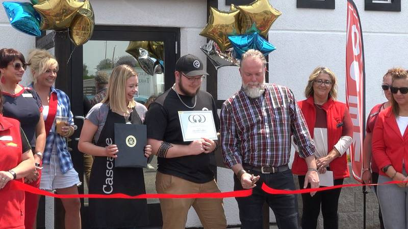 Wes Connell and Cascade Coffee staff cutting the ribbon at the grand opening Thursday afternoon.