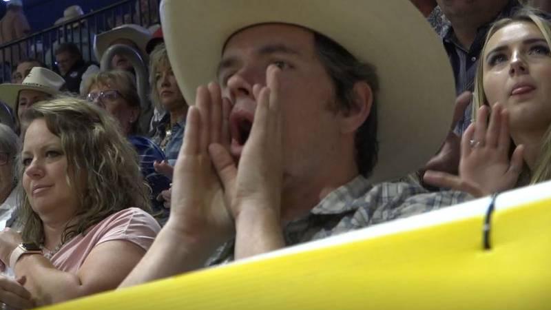 Dr. Daniel Jones cheers on a breakaway roper at the College National Finals Rodeo in Casper,...