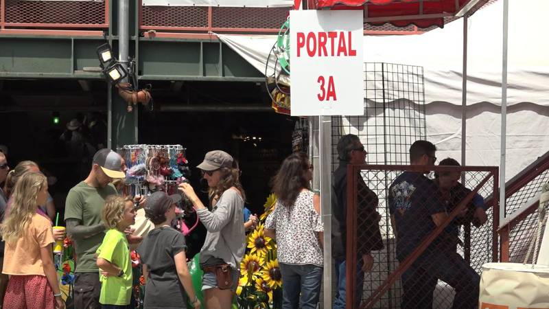 People wait to go into the stands for the rodeo at Cheyenne Frontier Days on Friday July 30,...