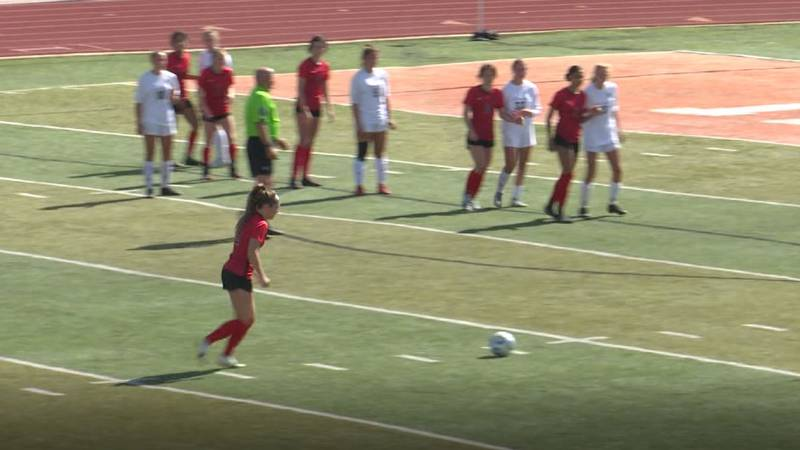 Eliza Grace Smith lines up for a free-kick just outside the box in the first round of the 2021...