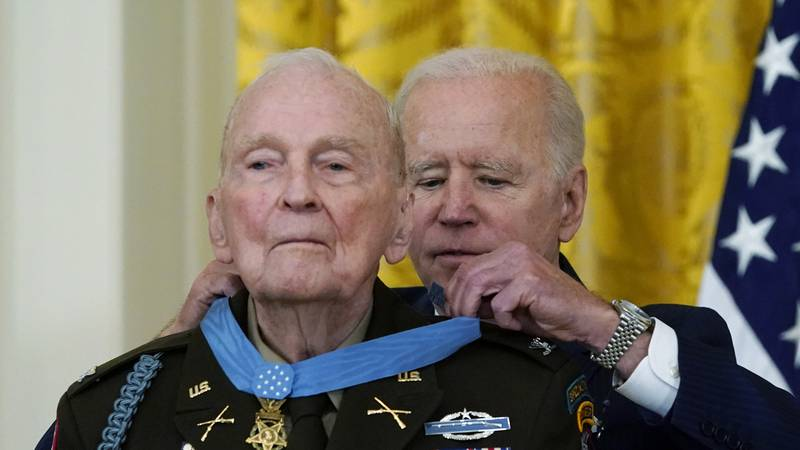 President Joe Biden presents the Medal of Honor to retired U.S. Army Col. Ralph Puckett, in the...