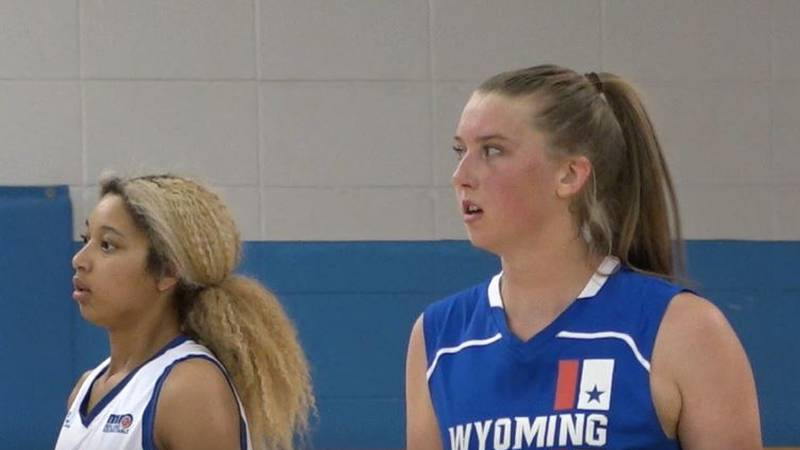 Wyoming All-Star Allyson Fertig looks to the bench for guidance after making a shot in the...