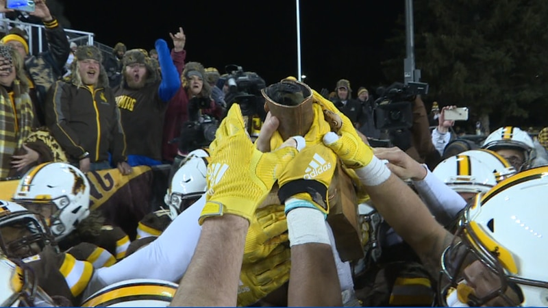 The Pokes celebrate with the Bronze Boot as they win the 111th annual Border War last year.