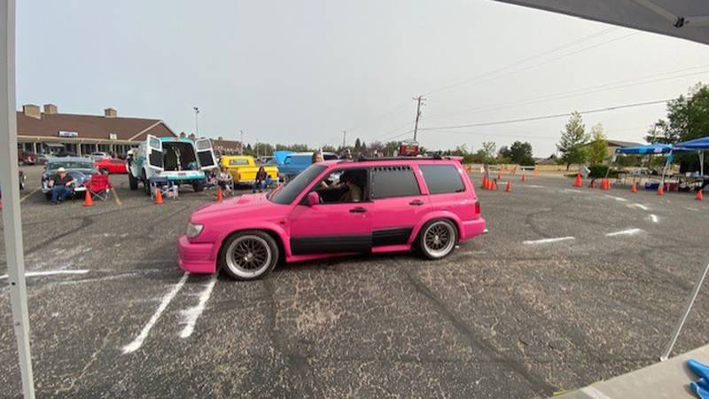 "Community members enjoy the Wyoming Corvette Club car show and ""funkana"""