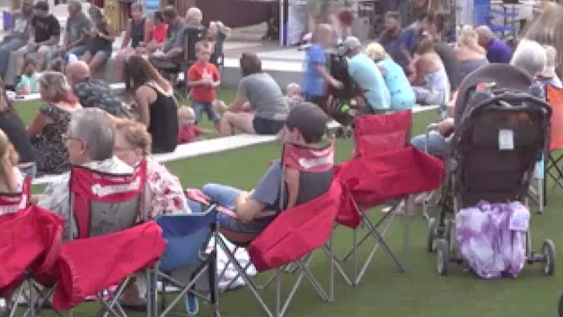 People on the David Street Station lawn during the 5150 Festival in Casper, Wyo. on Saturday,...