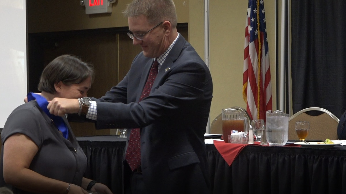 KCWY General Manager Jim Beck gives Miamie Sleep a medal on Sept. 7