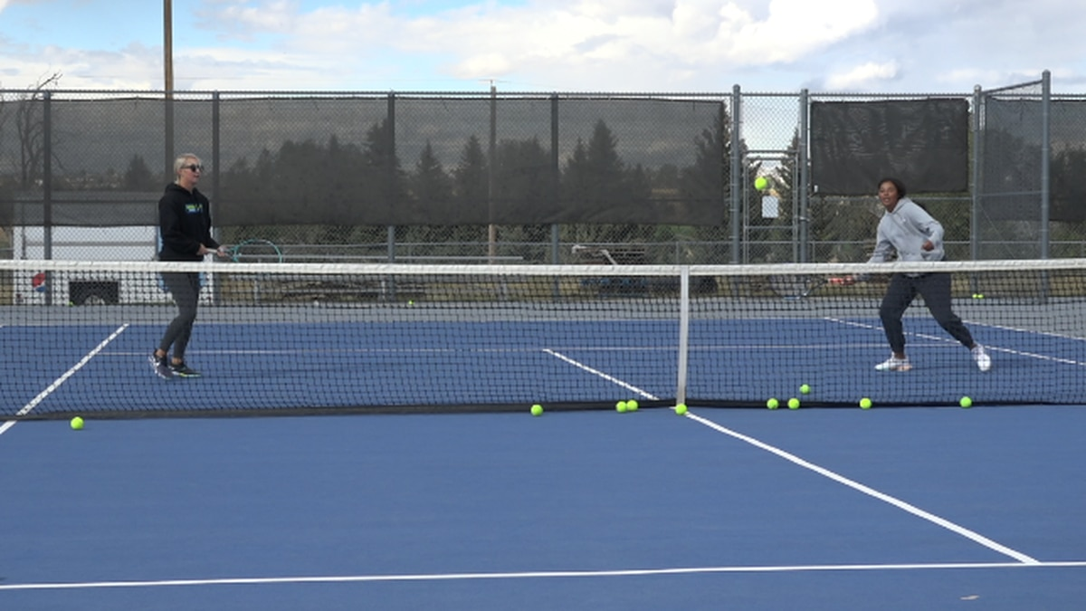 The East HS Girls Tennis Team Practicing