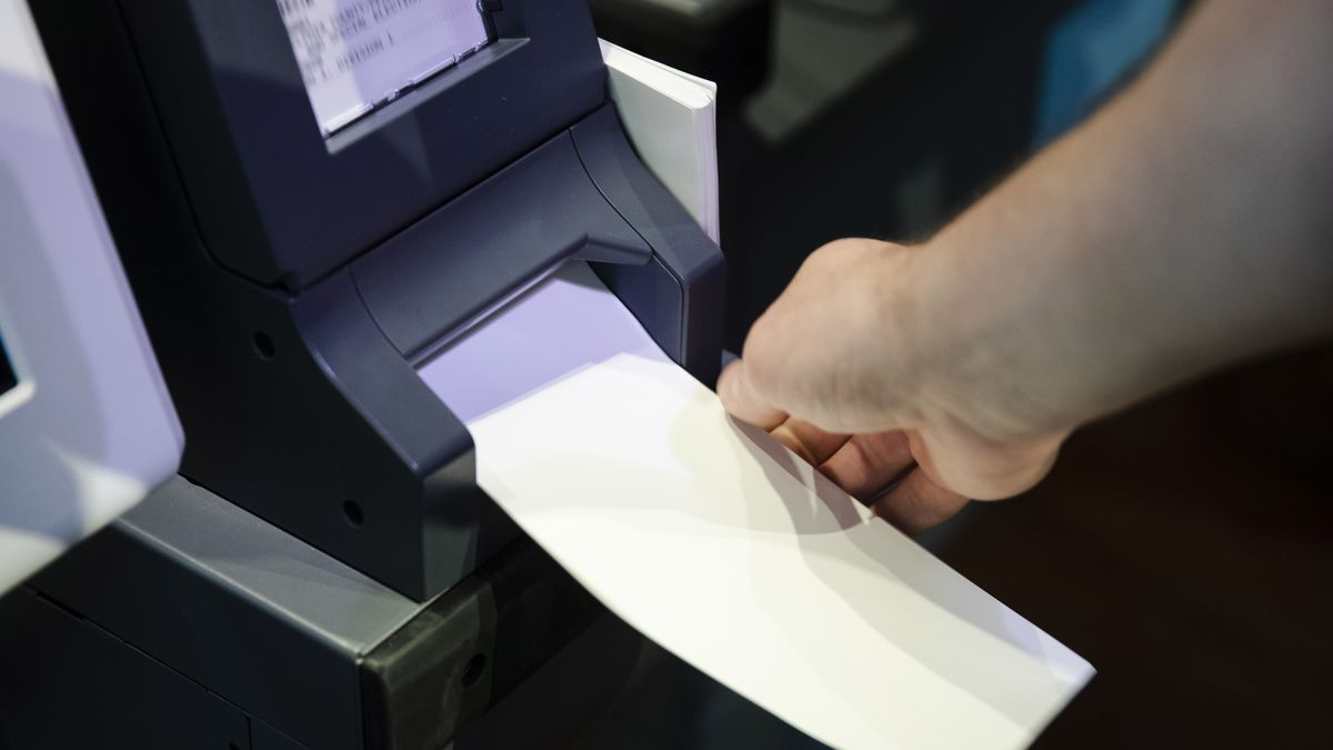 """FILE—In this June 13, 2019 file photo, an Investigator with the Office of the City Commissioners, demonstrates the ExpressVote XL voting machine at the Reading Terminal Market in Philadelphia.   As the Nov. 3 2020 presidential vote nears, there are fresh signs that the nation's electoral system is again under attack from foreign adversaries. Intelligence officials confirmed in recent days that foreign actors are actively seeking to compromise the private communications of """"U.S. political campaigns, candidates and other political targets"""" while working to compromise the nation's election infrastructure."""