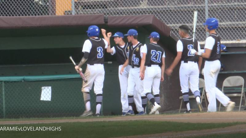 Diego Medina (#3) is congratulated after scoring to give Laramie its first lead of the game.