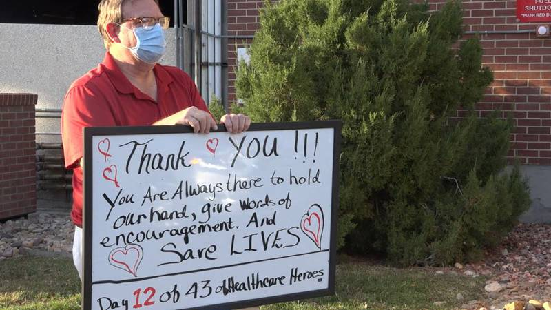 Daren Bulow stands outside of Wyoming Medical Center at shift changes