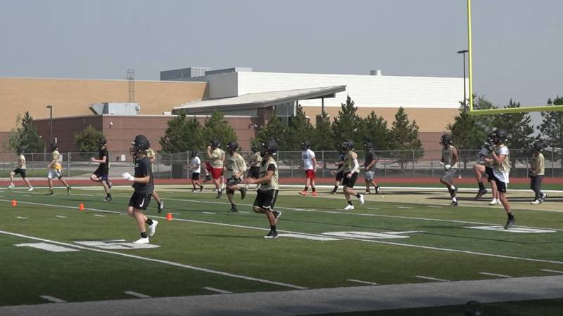 South football players get loose during preseason practice on Tuesday, August 10.