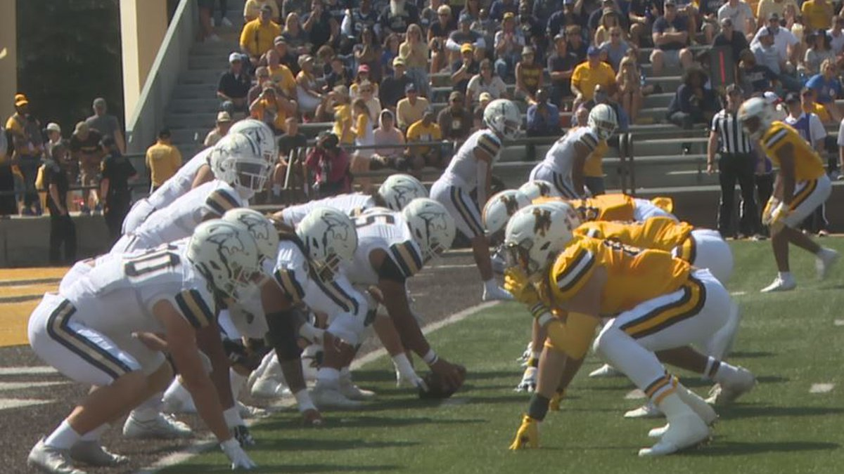 The University of Wyoming defensive line lines up during the first game of the season against...