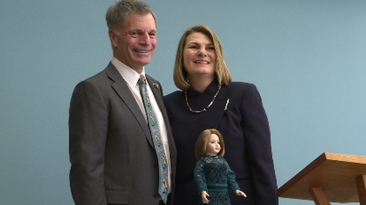 Governor Mark Gordon, right, and first lady Jennie Gordon, left, pose with the doll in Jennie Gordon's honor.
