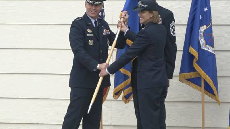 General Lutton handing the Wing Flag to Col. Barrington to assume command of the 90th Missile...