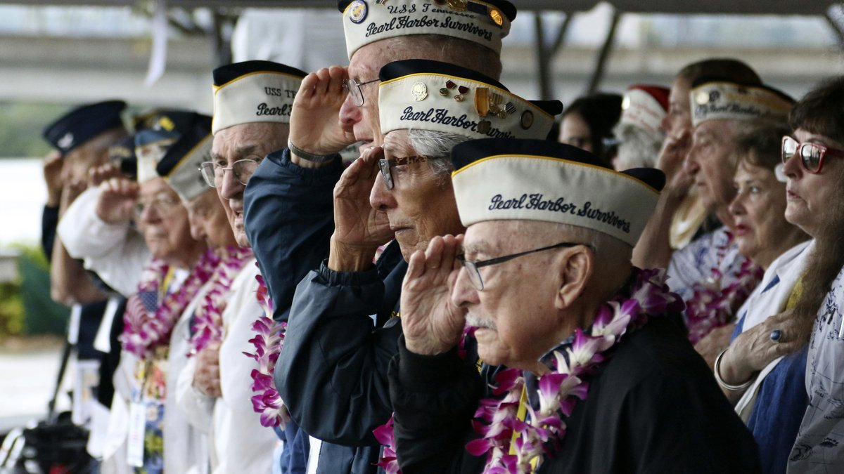 FILE - In this Dec. 7, 2018, file photo, Pearl Harbor survivors salute during the National...