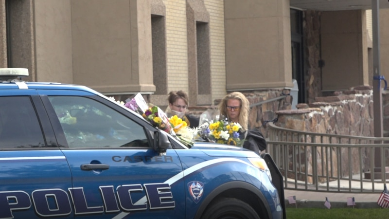 Casper residents place flowers on Officer Dundas' vehicle.
