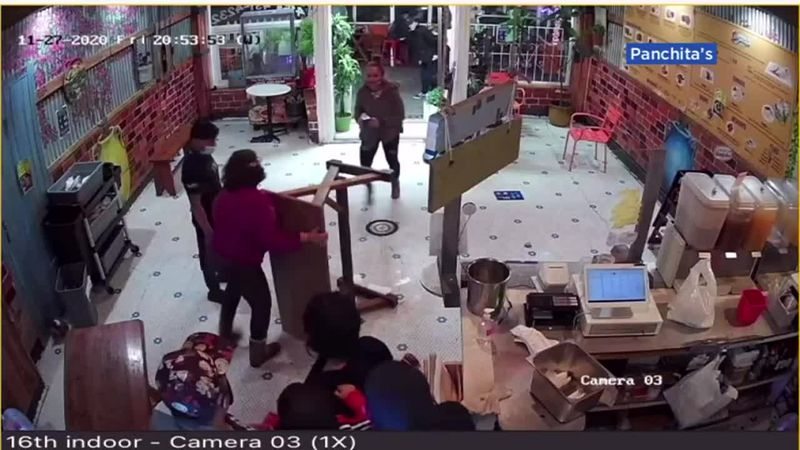 A restaurant owner had to defend her family from an attacking customer.