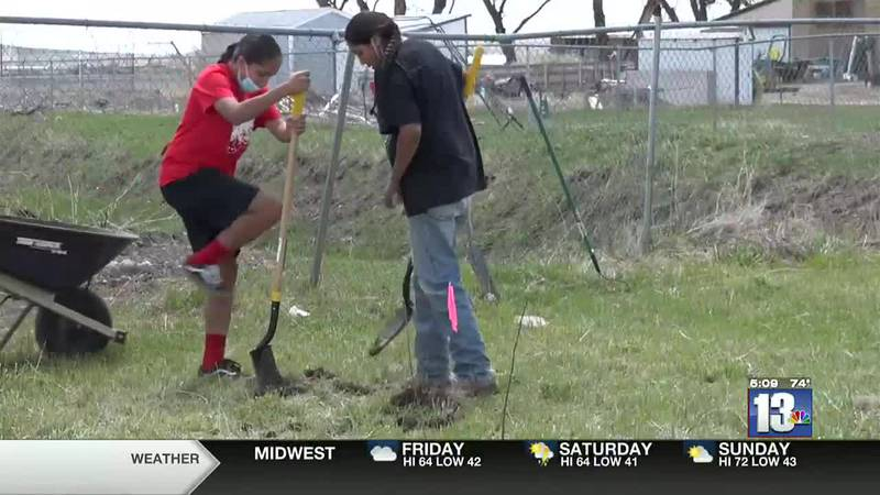 Fort Washakie Middle School students breaking ground to plant a chokecherry tree May 13, 2021