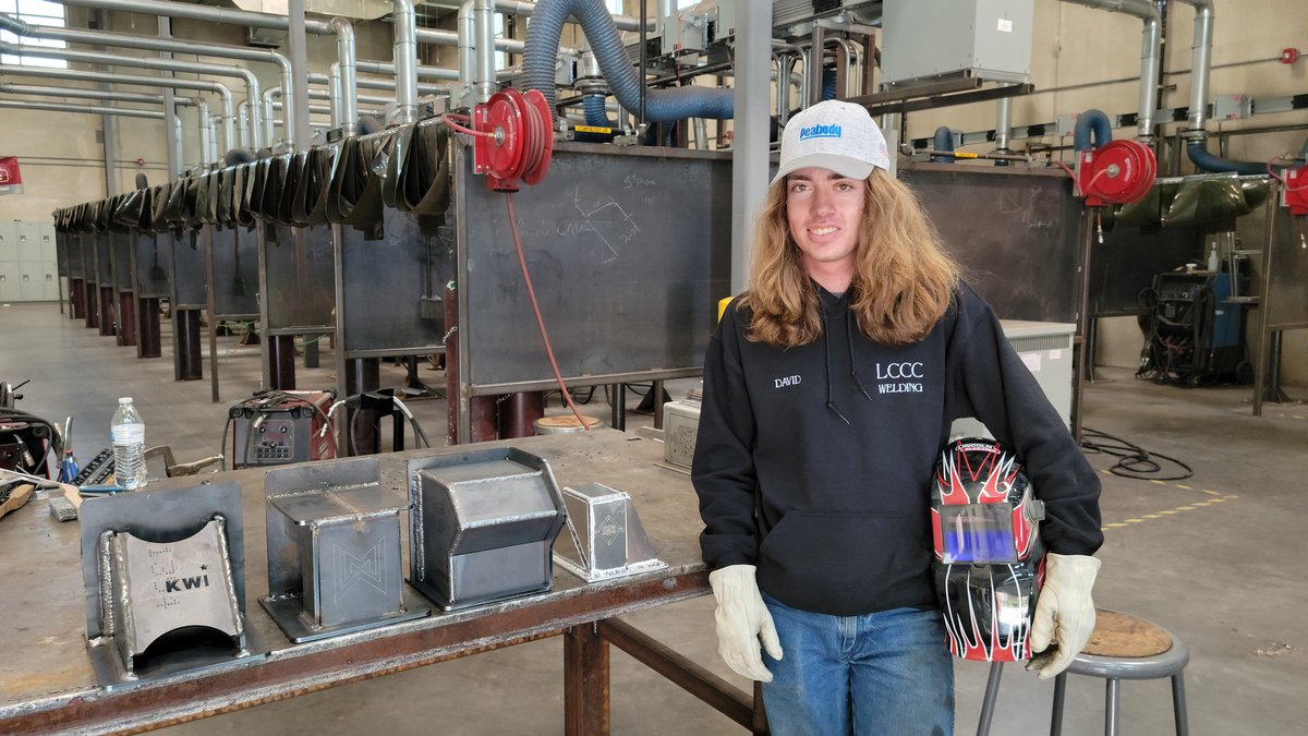 LCCC Welding graduate, David Gordon, stands in front of the series of welds that earned him the...