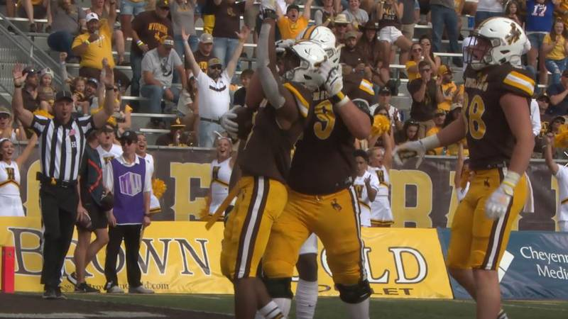 University of Wyoming's Xazavian Valladay points to the heavens after scoring a touchdown...
