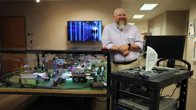 Troy Amick, program director, information technology at LCCC shows off the datacenter carts and...