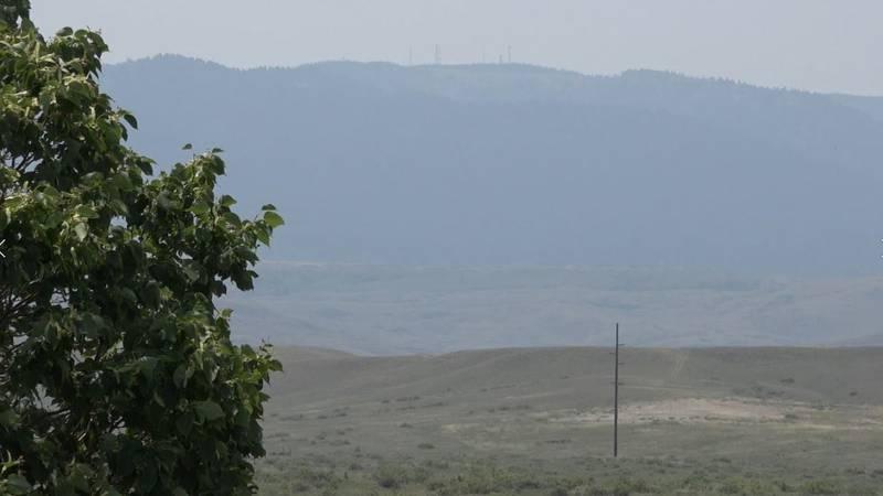 A hazy Casper Mountain on the East side of Casper