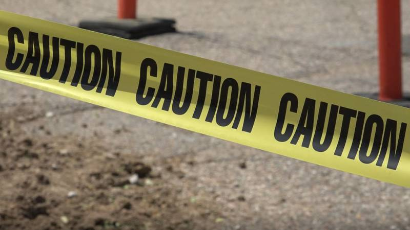 Caution tape surrounding a portion of the 26th Street Storm Sewer Extension Project on June 15,...
