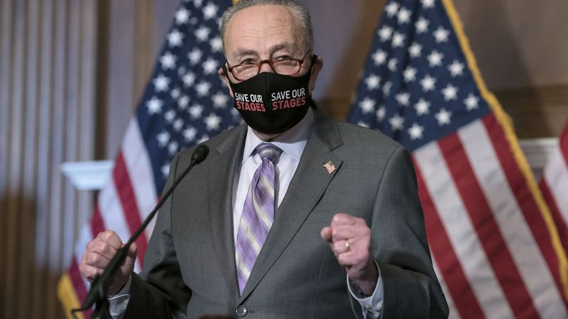Senate Majority Leader Chuck Schumer, D-N.Y., makes a statement to reporters as the second...