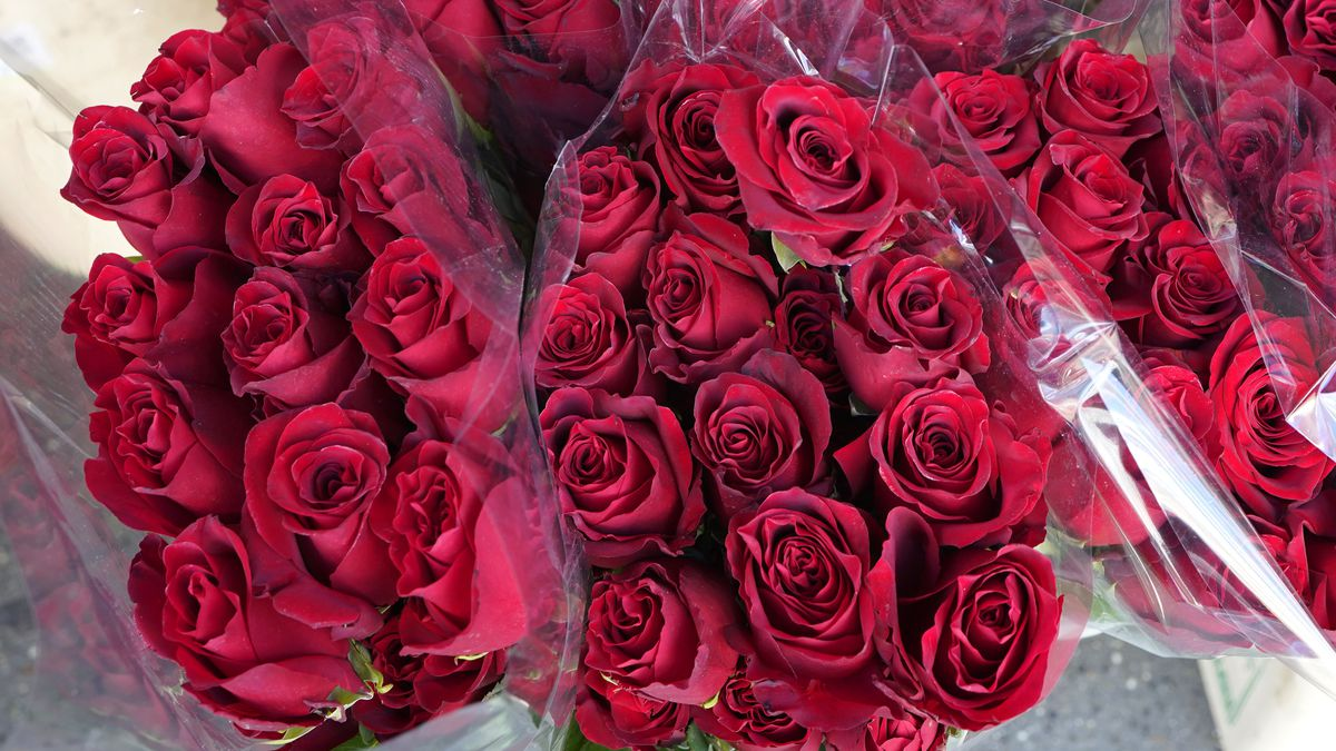 Bunches of red roses are shown, Tuesday, Feb. 9, 2021, at Pike Place Flowers at the Pike Place...
