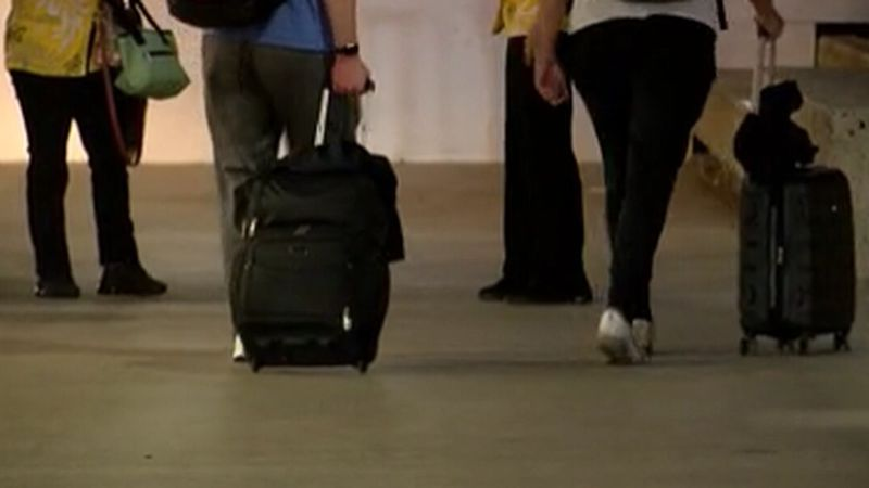 The state says about 100,000 people have arrived at Hawaii's airports in the past week.