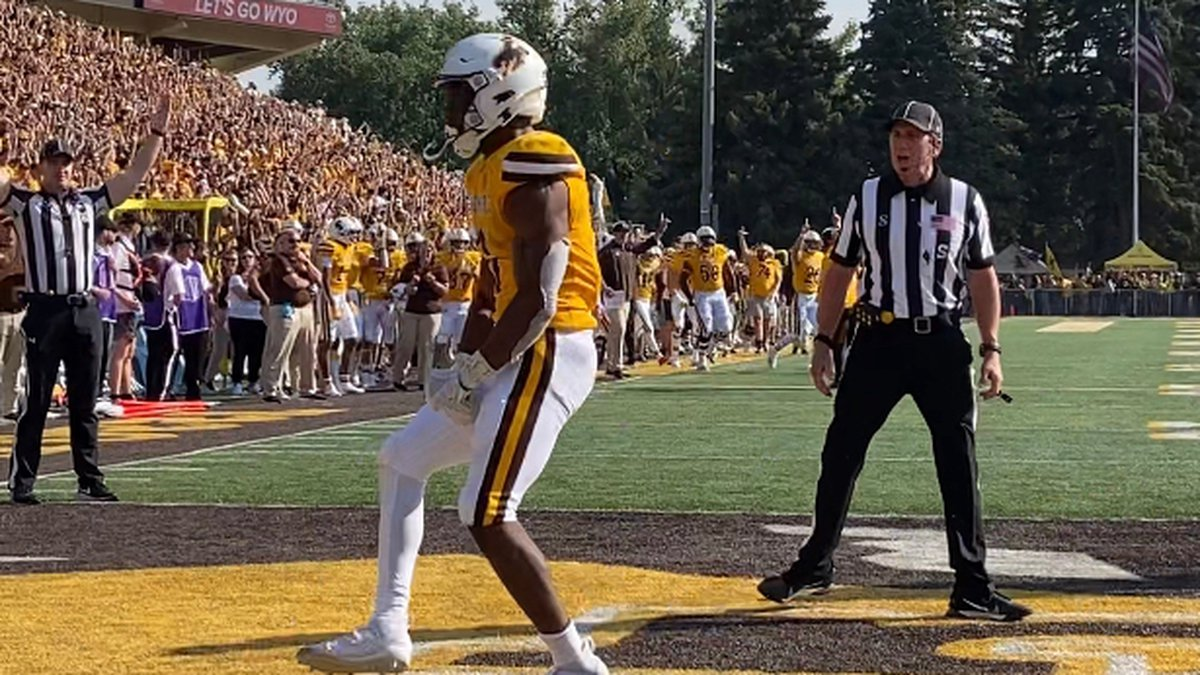 University of Wyoming Running Back Xazavian Valladay celebrates in the end zone after scoring a...