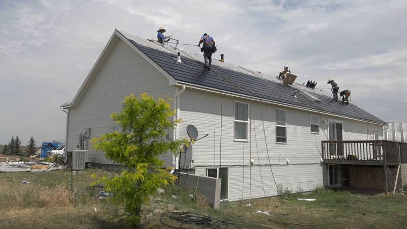 Weddle and Sons Roofing crews install the Tesla Solar Roof at a Cheyenne resident's home on...