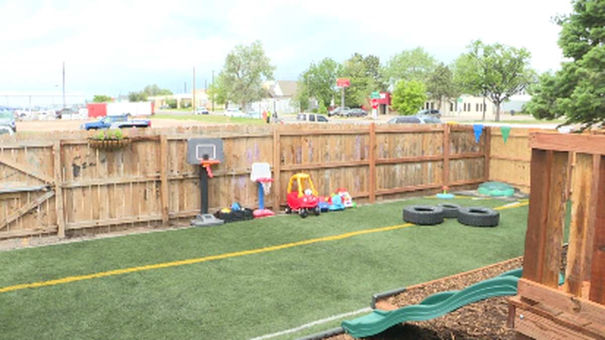 The Neighborhood School uses old turf from UW football practice facility for new playground.