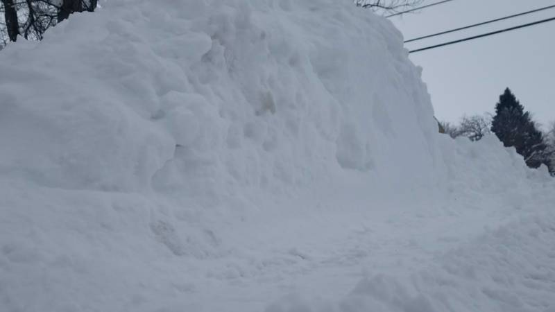 Snow piles on the side of a street in Cheyenne, Wyoming