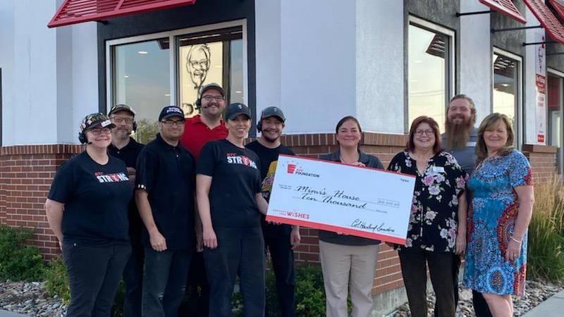 The Casper KFC team with members of the Mimi's House team