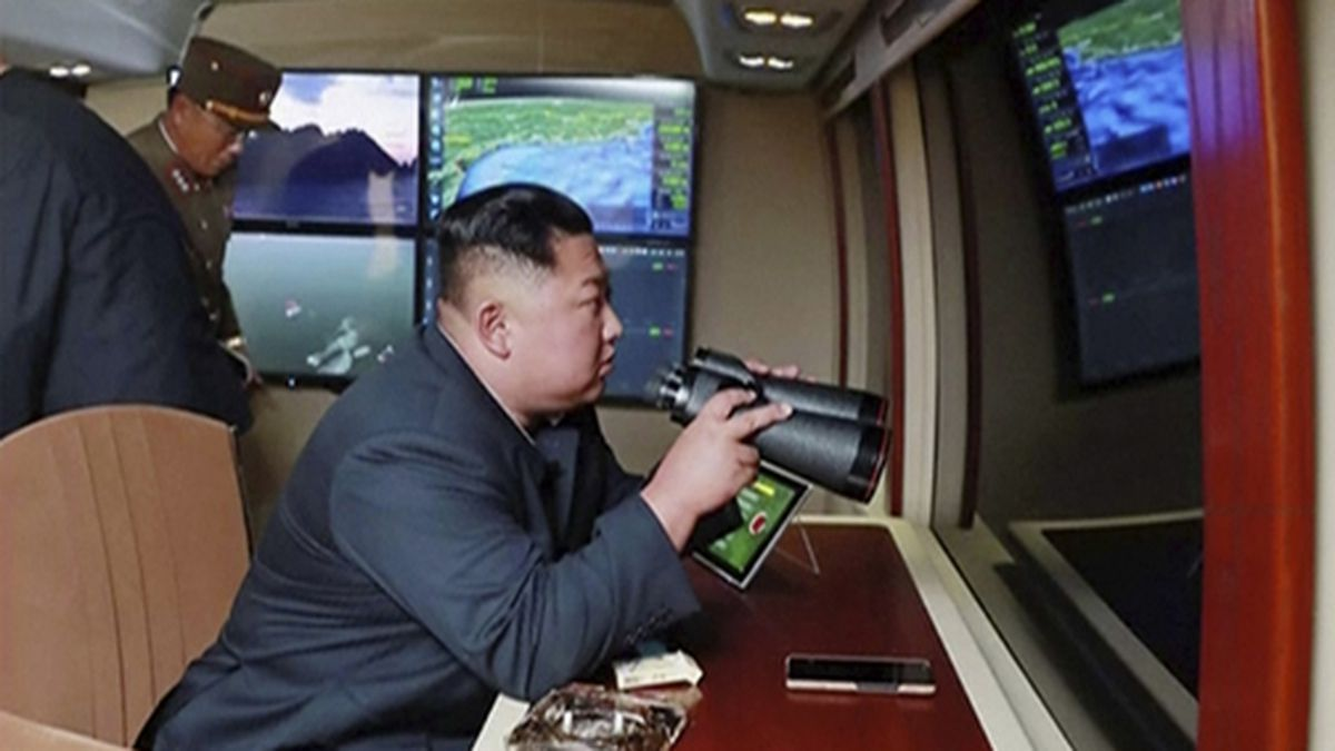 In this image made from video of a still image broadcast by North Korea's KRT on Thursday, Aug. 1, 2019, North Korean leader Kim Jong Un, equipped with binoculars, supervises a rocket launch test. (KRT via AP Video)