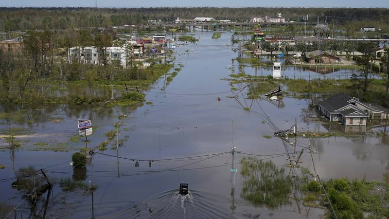 FILE - Homes, businesses and roads are flooded in the aftermath of Hurricane Ida in LaPlace,...
