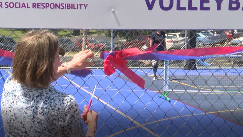 Cheyenne Family YMCA CEO Patty Walters ceremonially opens the new sport court.