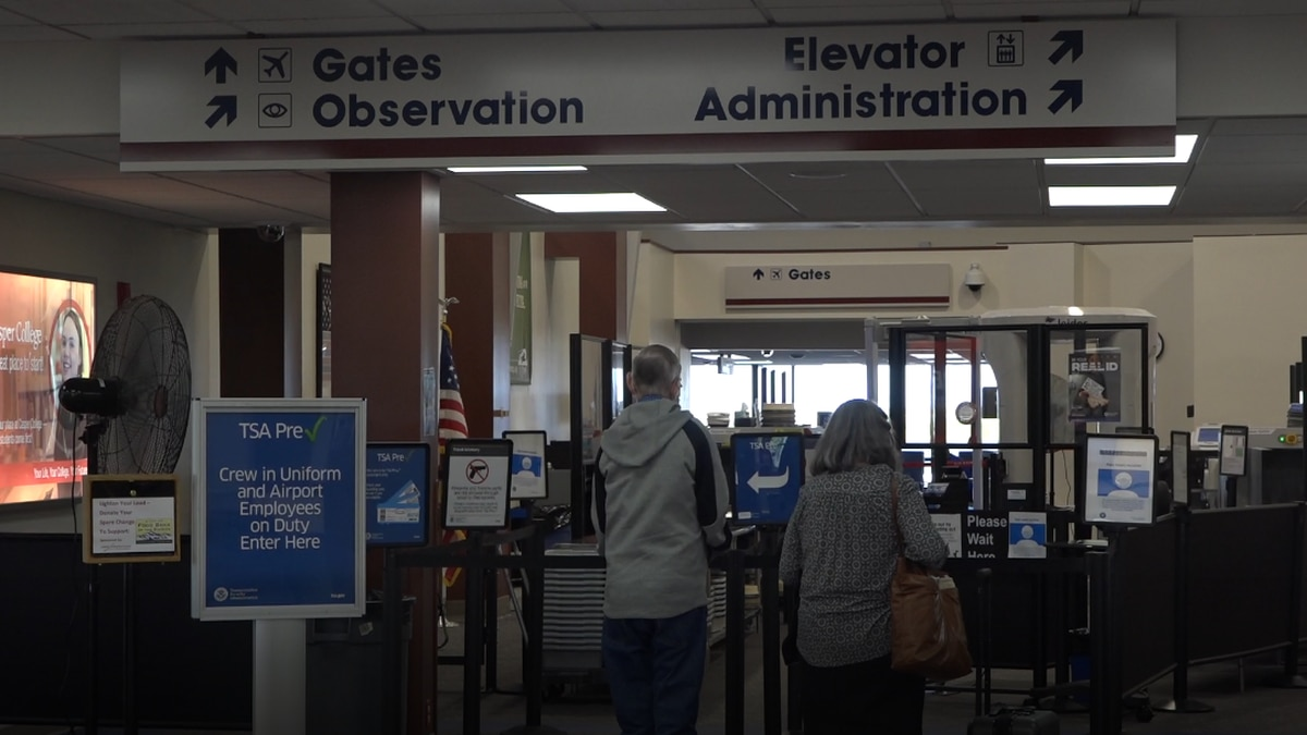 Travelers go through security at CPR on June 22