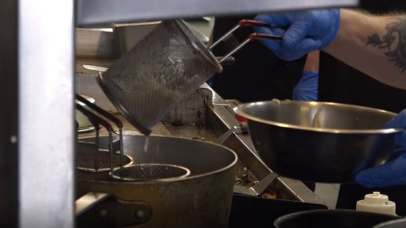 A Branding Iron restaurant cook preparing food in Casper, Wyo. on Friday, May 8, 2020.