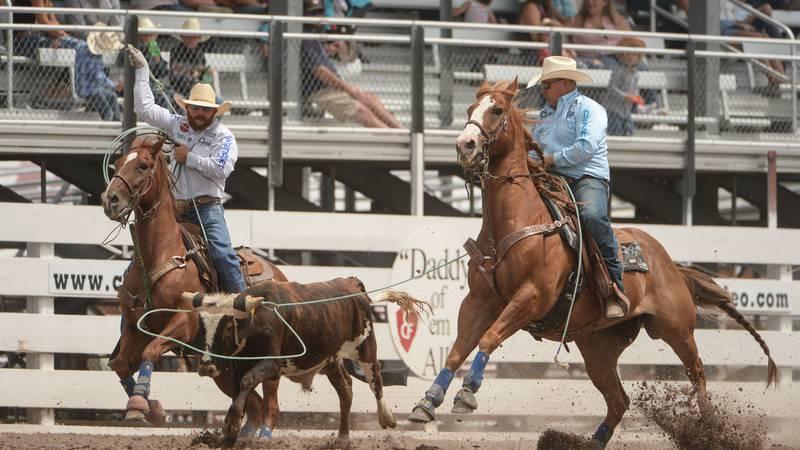 Team ropers Levi Simpson from Ponoka, Alberta and Tyler Worley from Berryville, Arkansas tied...