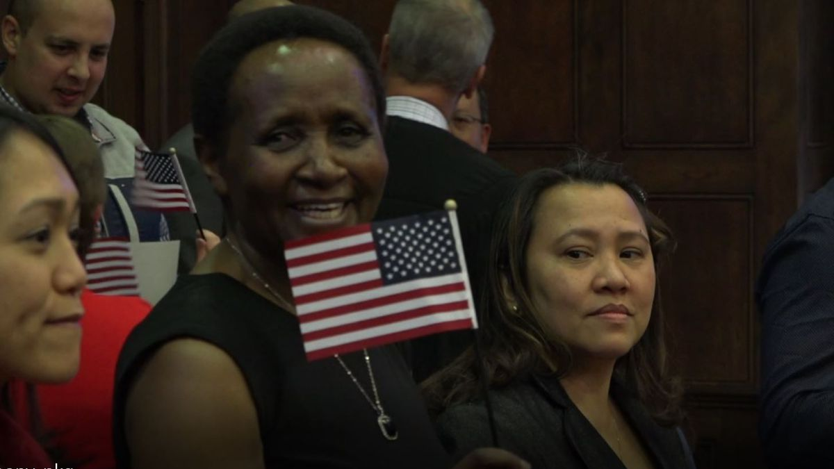 Salome Kerecha waves a mini American flag after being sworn in as a U.S. citizen in Casper, Wyo. on Monday, Jan. 13, 2020.