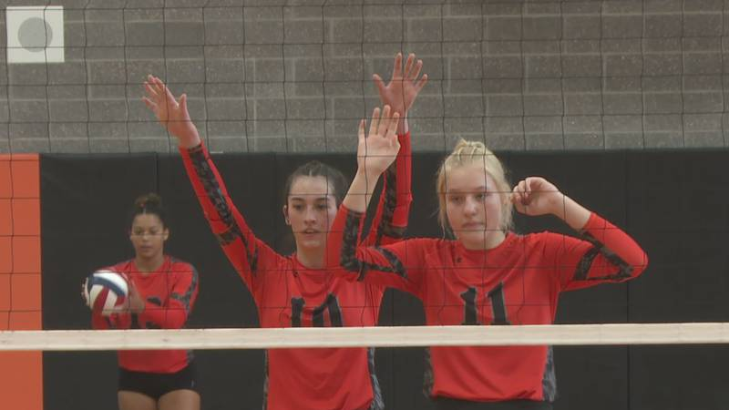 Natrona County volleyball players line up at the net during a match against Jackson on October...