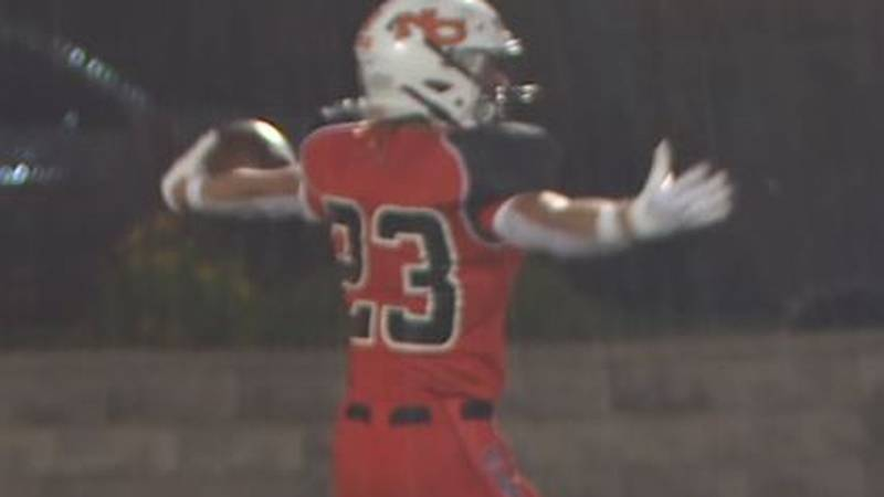 Natrona County Senior Kaeden Wilcox begins to celebrate after picking off his first pass...