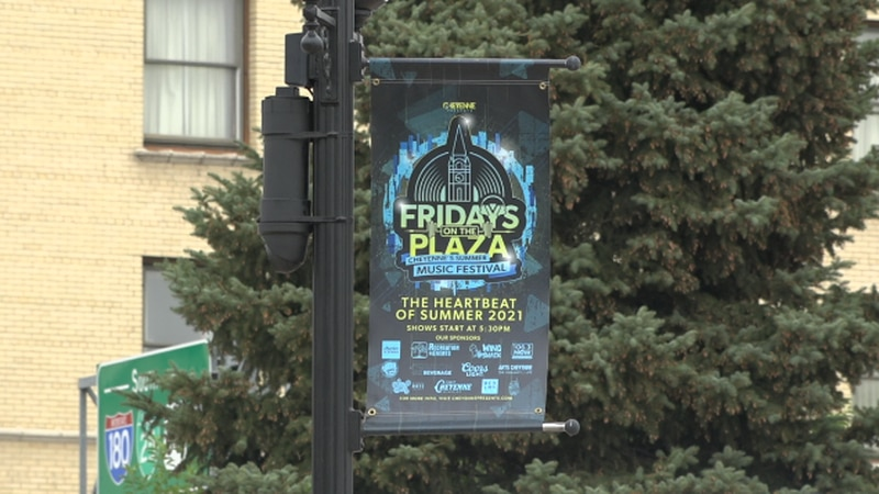 A Fridays On The Plaza Sign hanging from a pole in Cheyenne, WY