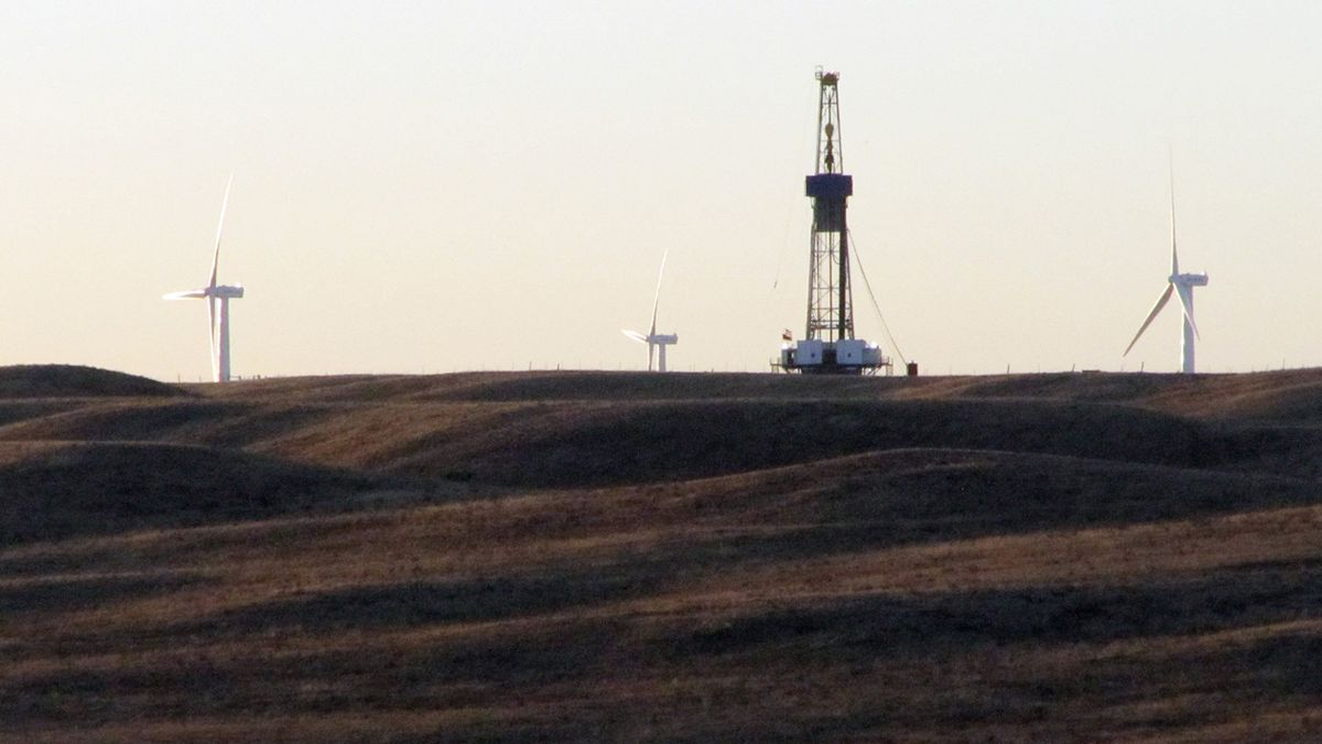 A rig drilling an oil well for QEP Resources Inc., is shown on ranch land a few miles west of...