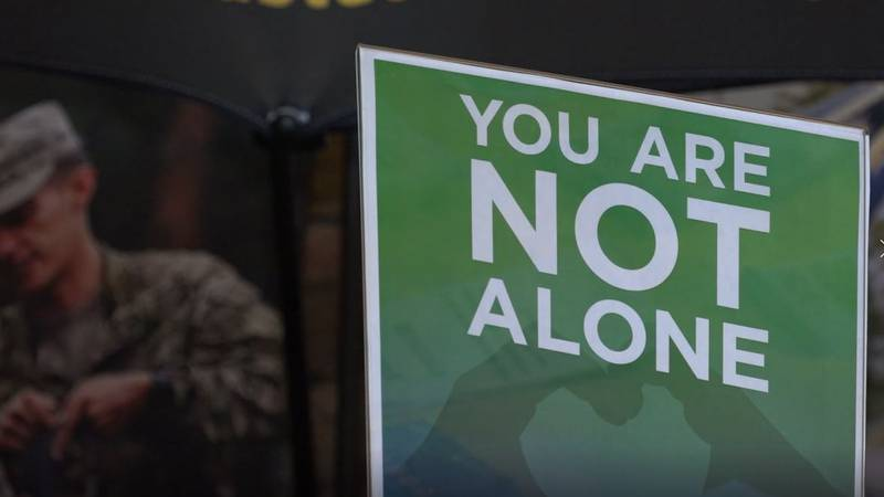 """A sign reminding military members that """"you are not alone"""" at the Joint Forces Readiness Center..."""