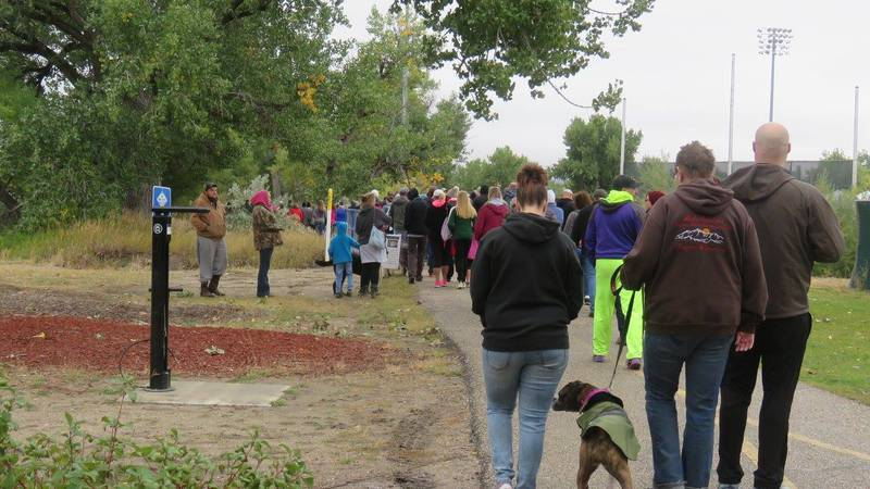 Participants walk in the Breaking the Silence Walk for the suicide prevention task force