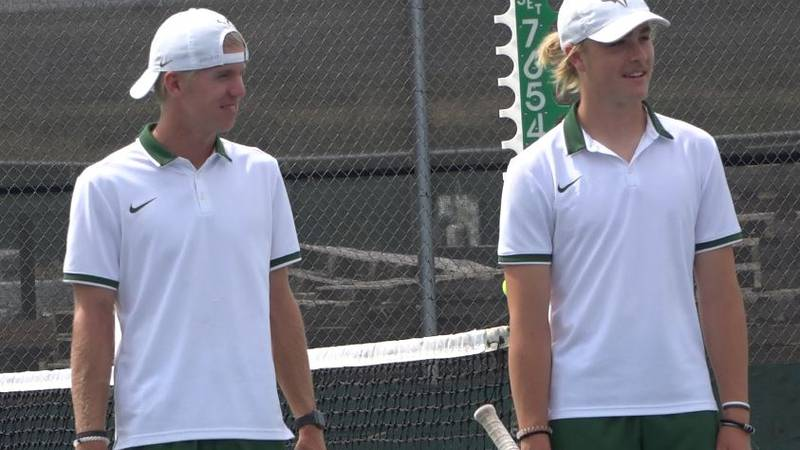 Kelly Walsh's Jackson Catchpole and Drew Rasmussen watch their teammates warm up before a...