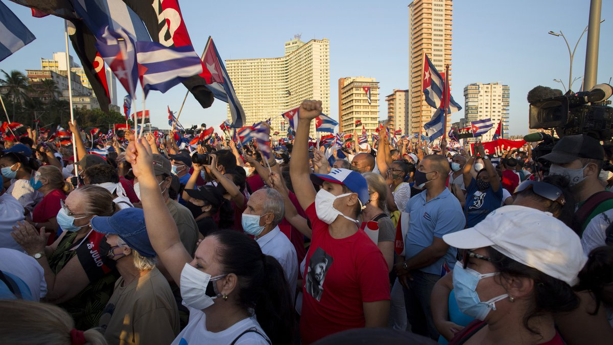 FILE - People attend a cultural-political event on the seaside Malecon Avenue with thousands of...